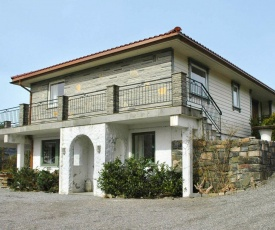 Three-Bedroom Holiday home in Ostereidet