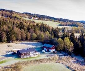 Bynær hytte med utsikt og uteplass